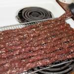 applying snack sticks to grill