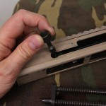 removing charging handle
